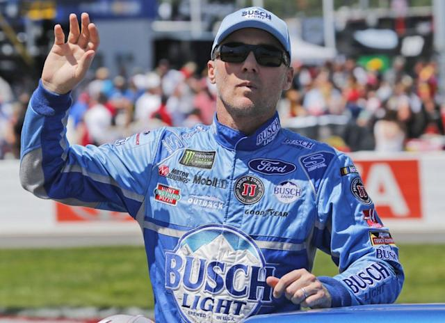 "<a class=""link rapid-noclick-resp"" href=""/nascar/sprint/drivers/205/"" data-ylk=""slk:Kevin Harvick"">Kevin Harvick</a> waves to the crowd during driver introductions prior to the race at Richmond International Raceway. (AP Photo/Steve Helber)"