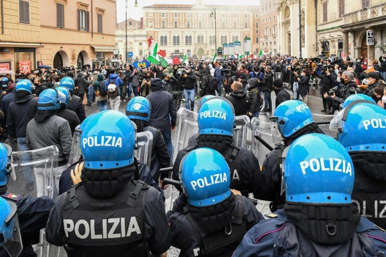 Riot police kept the protesters confined to a plaza in the city centre