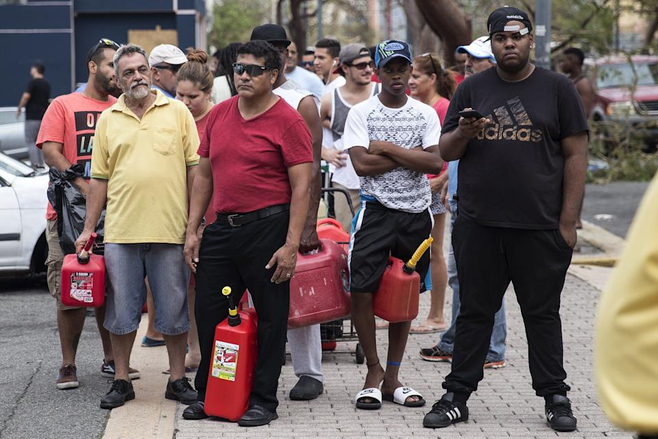 SAN JUAN, PUERTO RICO - SEPTEMBER 22: Residents line up for gasoline days after Hurricane Maria made landfall, on September 22, 2017 in San Juan, Puerto Rico. Many on the island have lost power, running water, and cell phone service after Hurricane Maria, a category 4 hurricane, passed through. (Photo by Alex Wroblewski/Getty Images)