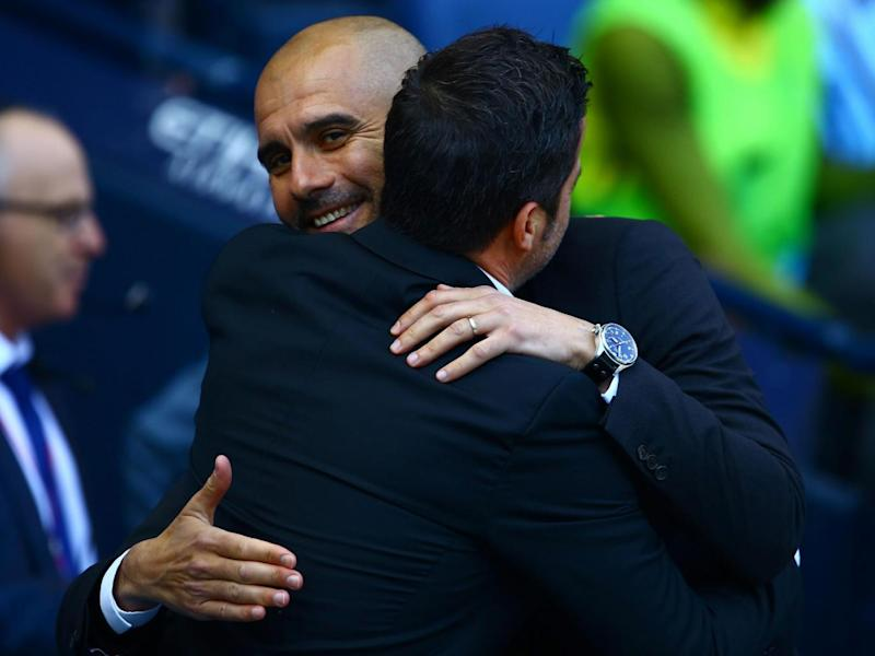 The two managers embrace ahead of kick-off (Getty)