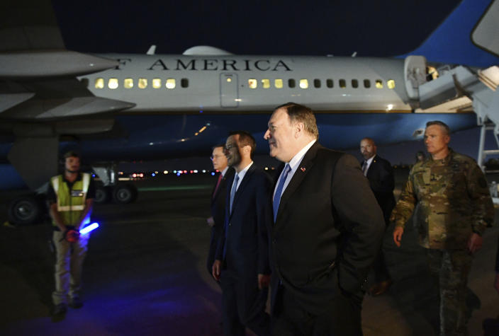 FILE - In this May 7, 2019 file photo, U.S. Secretary of State Mike Pompeo, center, walks with Acting Assistant Secretary for Near Eastern Affairs at the State Department David Satterfield, left, and Charge D'affaires at the U.S. Embassy in Baghdad Joey Hood, second from left, and Lt. Gen. Paul LeCamera after arriving in Baghdad. Tensions between the United States and Iran have soared in recent weeks, with Washington dispatching warships and bombers around the Persian Gulf, and Tehran threatening to resume higher uranium enrichment. (Mandel Ngan/Pool Photo via AP, File)
