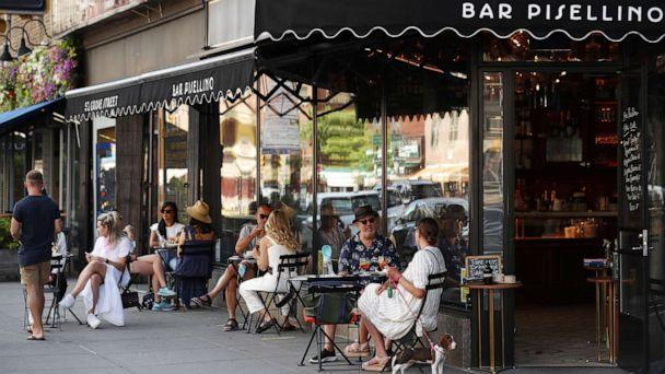 PHOTO: Customers practice social distancing in outdoor seating at seating that follows current health guidelines to slow the spread of Coronavirus (COVID-19) at a restaurant in New York City, June 25, 2020. (Lucas Jackson/Reuters)