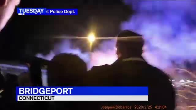 Officers pushed the vehicle -- which was on fire -- right side up, pulled the woman out through the passenger window and carried her to safety before the flames grew.