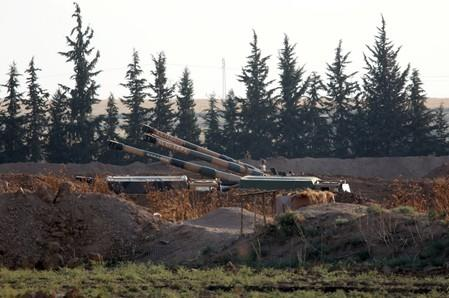 Turkish army howitzers are positioned on the Turkish-Syrian border, near the southeastern town of Akcakale in Sanliurfa province