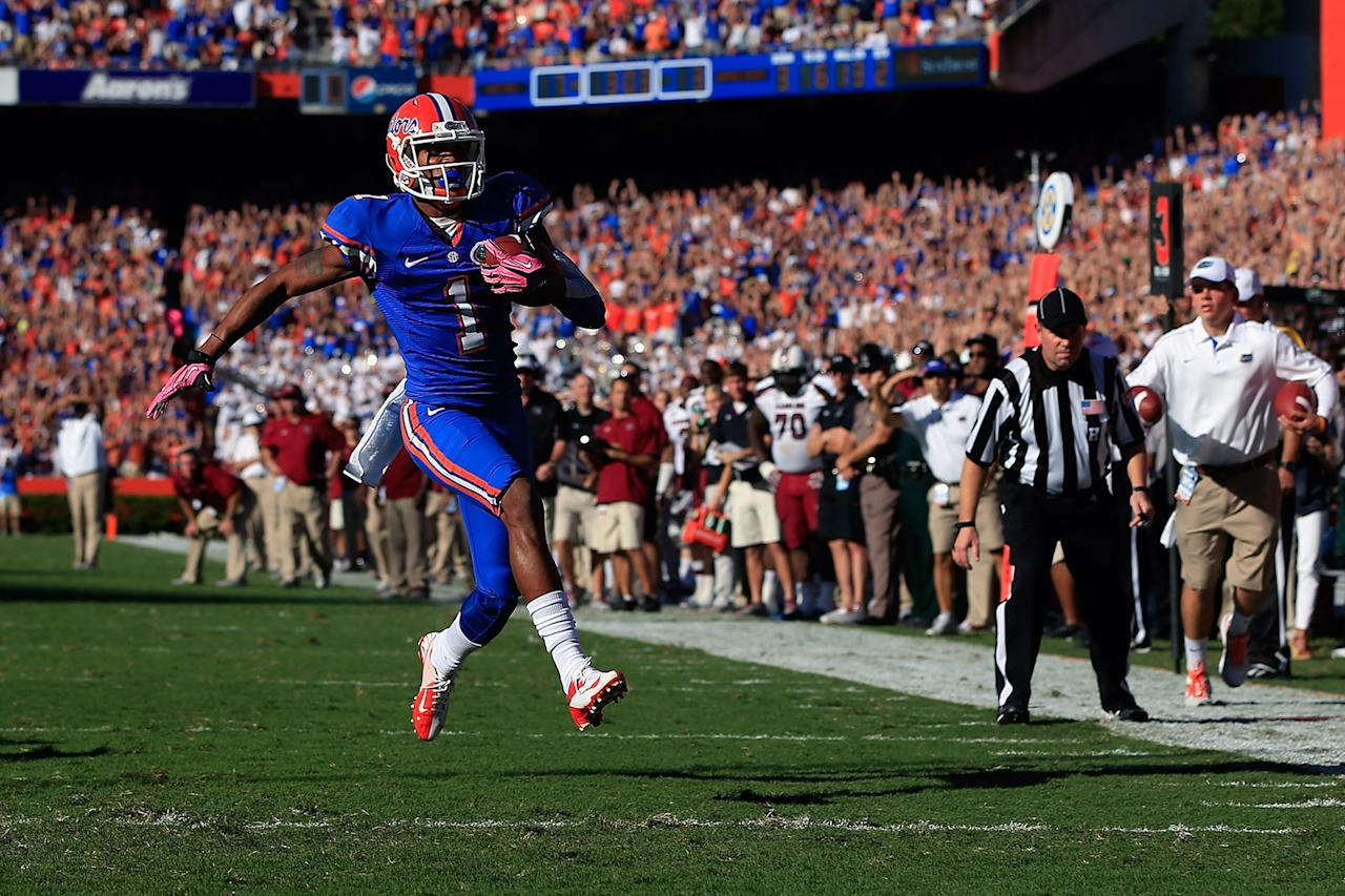 GAINESVILLE, FL - OCTOBER 20:  Wide receiver Quinton Dunbar #1 of the Florida Gators runs for a 13 yard touchdown in the second quarter against the South Carolina Gamecocks at Ben Hill Griffin Stadium on October 20, 2012 in Gainesville, Florida.  (Photo by Chris Trotman/Getty Images)