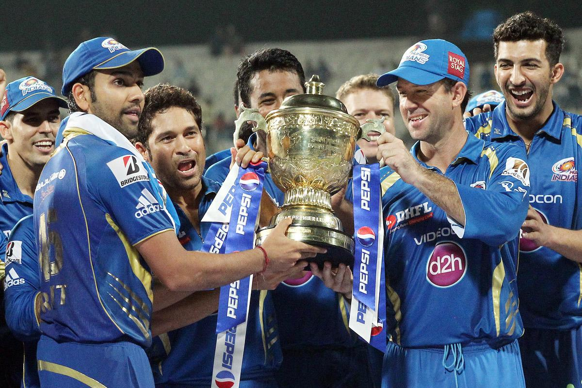 Mumbai Indians captain Rohit Sharma, Sachin Tendulkar of Mumbai Indians and Ricky Ponting of Mumbai Indians with the Pepsi Indian Premier League Trophy during the Final of the Pepsi Indian Premier League between The Chennai Superkings and the Mumbai Indians held at the Eden Gardens Stadium in Kolkata on the 26th May 2013.(BCCI)
