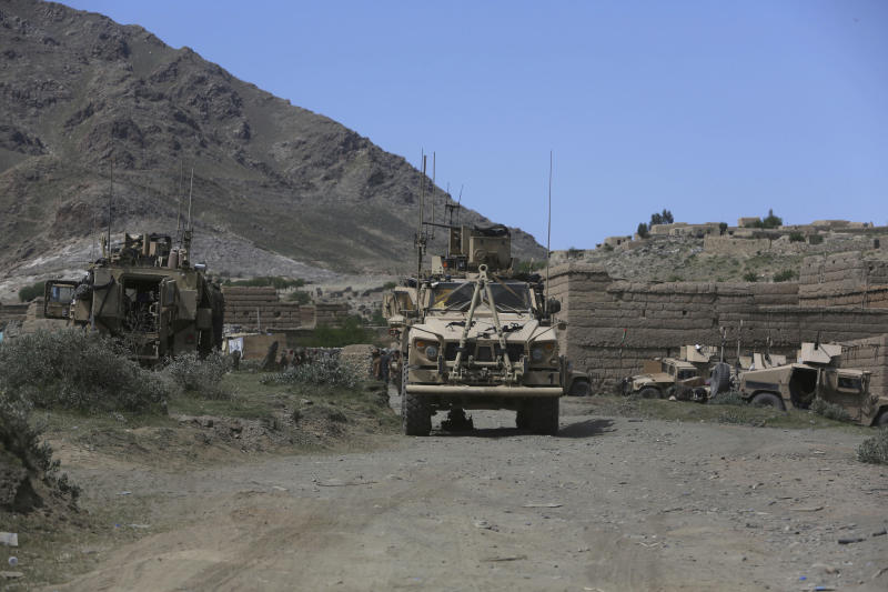 U.S. forces and Afghan commandos are seen in Asad Khil near the site of a U.S. bombing in the Achin district of Jalalabad, east of Kabul, Afghanistan, Saturday, April 17, 2017. U.S. forces in Afghanistan on Thursday struck an Islamic State tunnel complex in eastern Afghanistan with the largest non-nuclear weapon every used in combat by the U.S. military, Pentagon officials said. (AP Photo/Rahmat Gul)