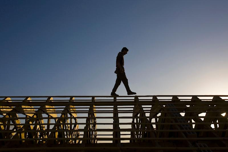 A Palestinian worker walks on a rooftop in the settlement of Beitar Ilit in the West Bank in December 2009. A Palestinian who works at the settlement was mistakenly arrested this month after a Facebook post was mistranslated