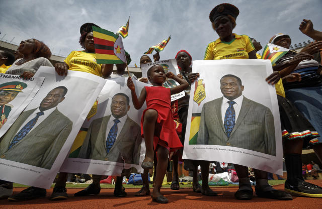 <p>A young girl marches in position as she mimics the military parade, accompanied by supporters holding posters of President Emmerson Mnangagwa, at his inauguration ceremony in the capital Harare, Zimbabwe Friday, Nov. 24, 2017. (Photo: Ben Curtis/AP) </p>