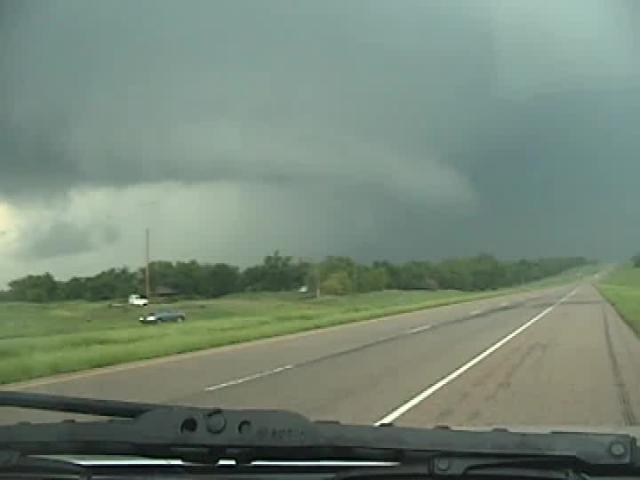 Storm spotter Dennie Bryson shot this video of a rain-wrapped tornado south of Stroud, Oklahoma May 20, 2013.