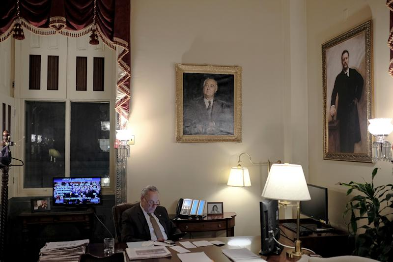Senate Minority Leader Chuck Schumer (D-N.Y.) watches the House vote on the articles of impeachment in his office at the Capitol in Washington, D.C., on Dec. 18, 2019. | Gabriella Demczuk for TIME
