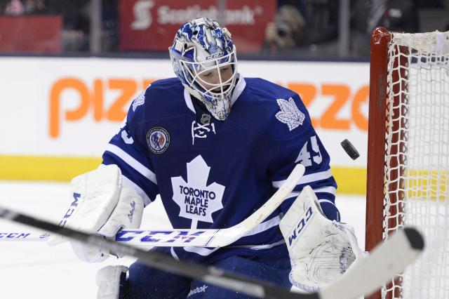 Toronto Maple Leafs goalie Jonathan Bernier watches as a puck goes into the net during the third period of an NHL hockey game, Friday, Nov. 8, 2013 in Toronto. (AP Photo/The Canadian Press, Frank Gunn)