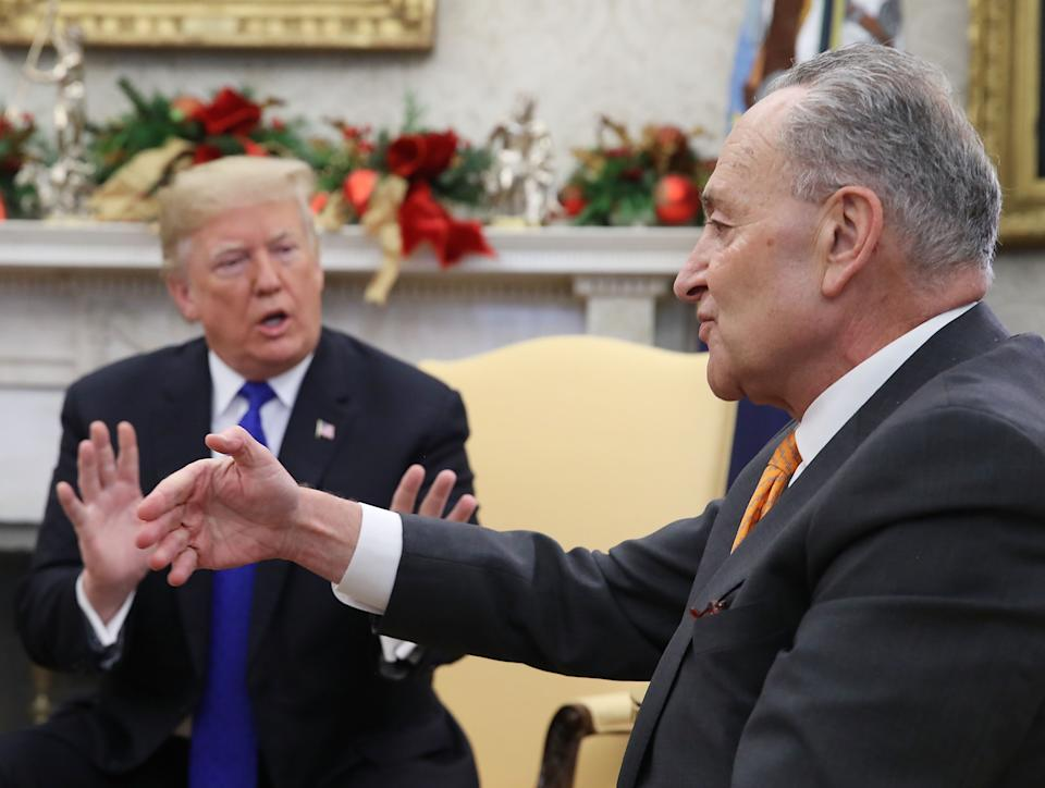 U.S. President Donald Trump argues about border security with Senate Minority Leader Chuck Schumer (D-NY) in the Oval Office on December 11, 2018 in Washington, DC. (Photo by Mark Wilson/Getty Images)
