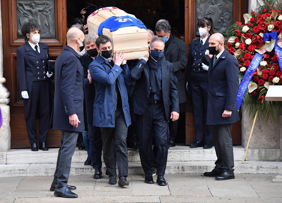Soccer Football - Funeral for former Italy player Paolo Rossi - Vicenza Cathedral, Vicenza, Italy - December 12, 2020 General view as the coffin of Paolo Rossi is carried outside the Vicenza Cathedral REUTERS/Daniele Mascolo