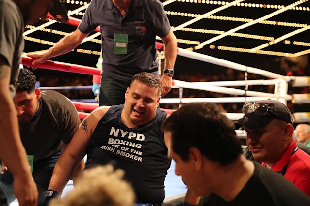 <p>Chris D'Antonio is helped out of the ring after injuring his knee in the ring during the NYPD Boxing Championships at the Theater at Madison Square Garden on June 8, 2017. (Photo: Gordon Donovan/Yahoo News) </p>