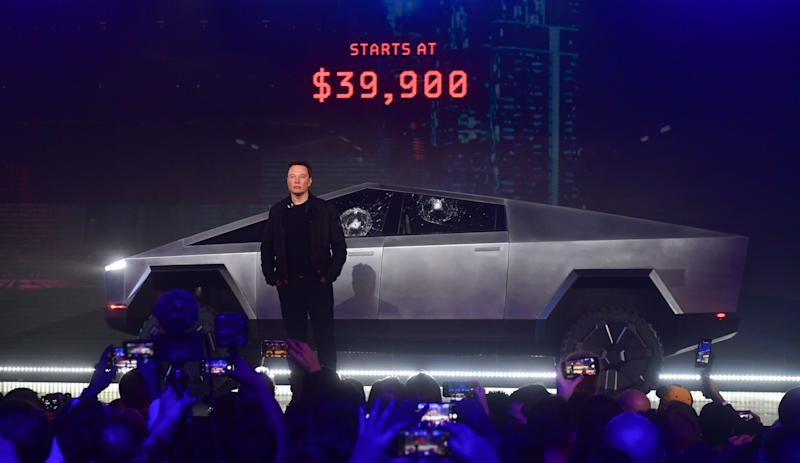 Tesla co-founder and CEO Elon Musk stands in front of the newly unveiled all-electric battery-powered Tesla's Cybertruck at Tesla Design Center in Hawthorne, California on November 21, 2019. (Photo by FREDERIC J. BROWN / AFP) (Photo by FREDERIC J. BROWN/AFP via Getty Images)