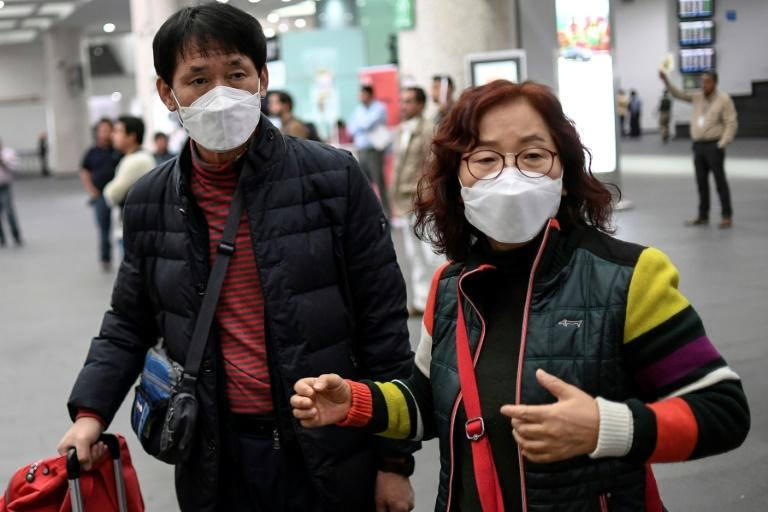 The coronavirus is another uncertainty for the global economic outlook and likely to cause disruption (AFP Photo/Pedro PARDO)