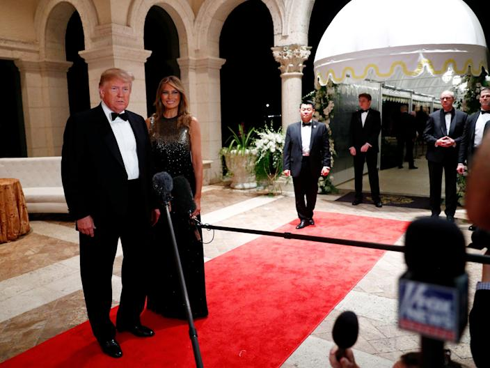 <p>US president Donald Trump and first lady Melania Trump at Mar-a-Lago</p> (REUTERS)