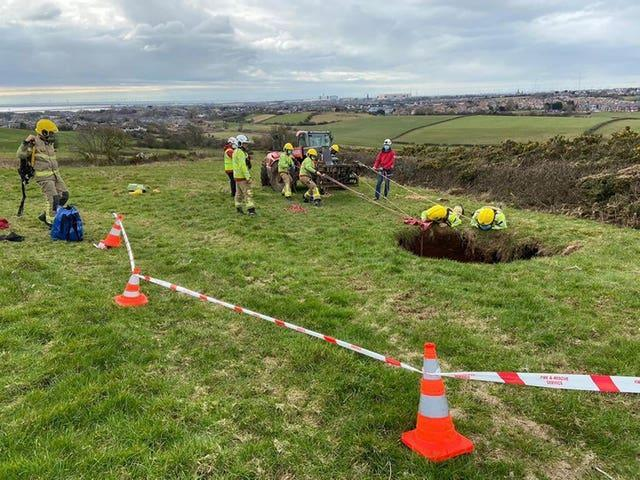 The rescue of a quad biker who fell into a 60ft sinkhole near Barrow-in-Furness in Cumbria
