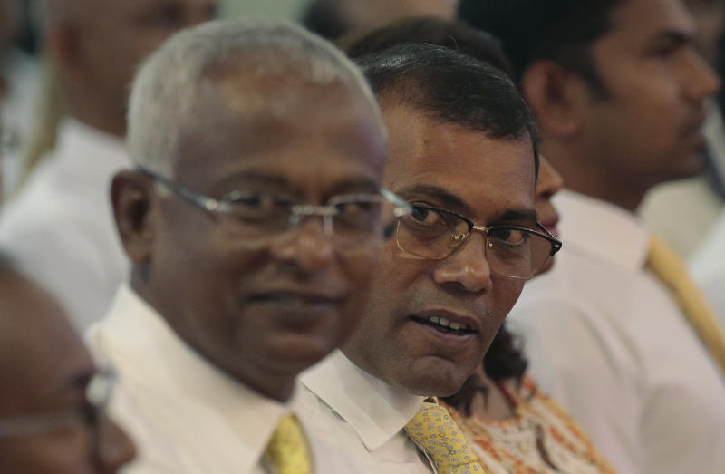 Former Maldivian President Mohamed Nasheed, right, and opposition presidential candidate Ibrahim Mohamed Solih, left, attend a meeting with the members of Maldivian community living in Sri Lanka, in Colombo, Sri Lanka, Monday, Aug. 27, 2018. Maldives' opposition presidential candidate has expressed fears that the next month's presidential election would not be free and fair, accusing that the government may rig the election. (AP Photo/Eranga Jayawardena)