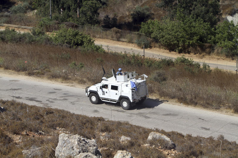 Spanish U.N peacekeepers patrol the Lebanese side of the Lebanese-Israeli border in the southern village of Kfar Kila, Lebanon, Monday, Aug. 26, 2019. Lebanon's state-run National News Agency said Monday that Israel's air force attacked a Palestinian base in the country's east near the border with Syria. Lebanese President Michel Aoun told the U.N. Special Coordinator for Lebanon, Jan Kubis, that the attacks violate a U.N. Security Council resolution that ended the 2006 war between Israel and Hezbollah. (AP Photo/Mohammed Zaatari)