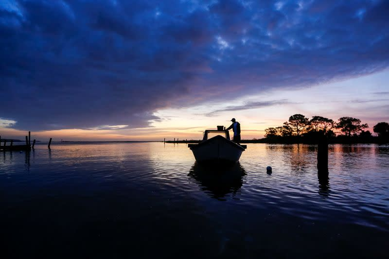 Frankie Crosby of Eastpoint, Florida, U.S., prepares his boat for a day of work harvesting oysters from Apalachicola Bay