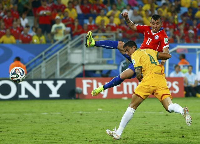 Australia's Tim Cahill (4) scores a goal that was later disallowed during their 2014 World Cup Group B soccer match against Chile at the Pantanal arena in Cuiaba June 13, 2014. REUTERS/Eddie Keogh (BRAZIL - Tags: SPORT SOCCER WORLD CUP)