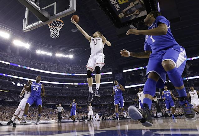 Connecticut guard Niels Giffey (5) drives to the basket in front of Kentucky guard James Young, right, during the first half of the NCAA Final Four tournament college basketball championship game Monday, April 7, 2014, in Arlington, Texas. (AP Photo/David J. Phillip)