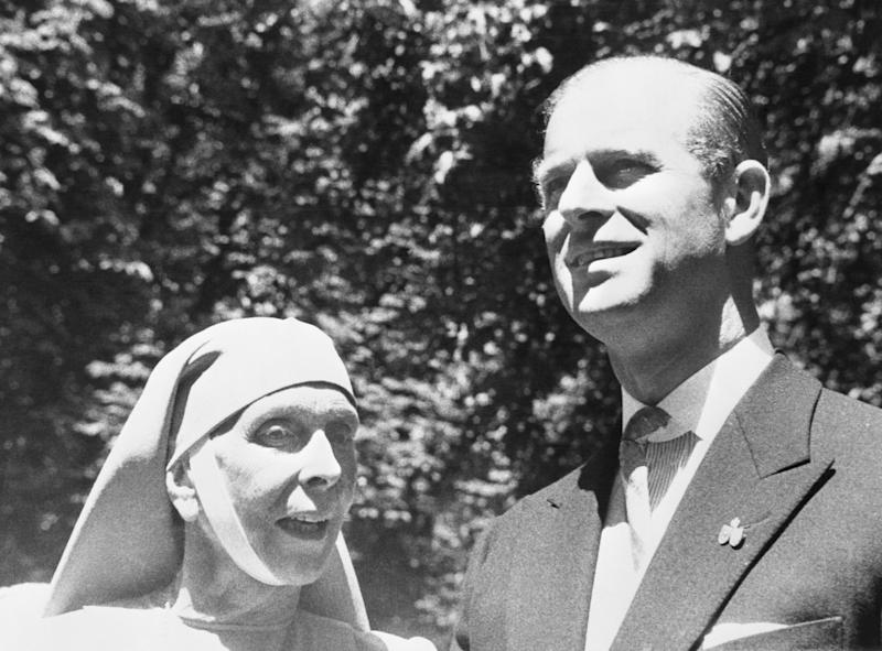 Prince Philip, Duke of Edinburgh, husband of Britain's Queen Elizabeth II, is shown in a reunion with his mother, Princess Alice of Greece. They met when both attended the marriage of Princess Margeritha of Baden and Prince Tomislavof Yugoslavia. The wedding was performed in Salem Castle, seat off the House of Baden, near Lake Constance, last week. Princess Alice, widow of Prince Andrew of Greece is living a semi-cloistered life as a nun on the Aegean Island of Tinos, where she has formed an order of deaconesses. She wears a habit similar to that of the Greek Orthodox religious orders.