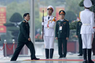 Vietnam's Defense Minister Ngo Xuan Lich, left, arrives for the opening ceremony of the 13th National Congress of Vietnam's Communist Party (VCP), in Hanoi, Vietnam, Tuesday, Jan. 26, 2021. (AP Photo/Minh Hoang)
