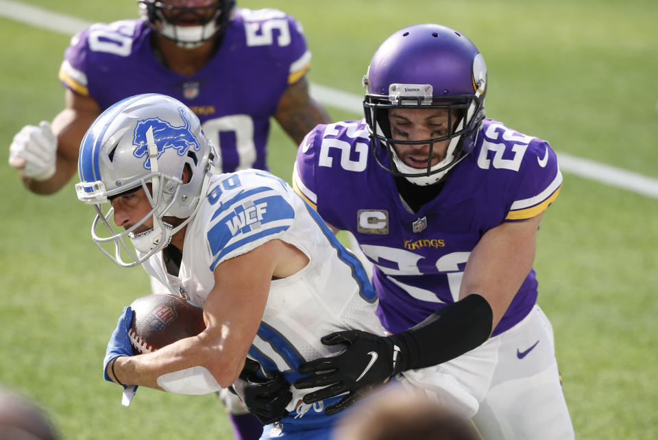 FILE - In this Nov. 8, 2020, file photo, Detroit Lions wide receiver Danny Amendola (80) tries to break a tackle by Minnesota Vikings safety Harrison Smith (22) after catching a pass during the first half of an NFL football game in Minneapolis. The Vikings have signed five-time Pro Bowl safety Smith to a contract extension Sunday, Aug. 29, 2021, securing the team's longest-tenured player for what could be the remainder of his career. (AP Photo/Bruce Kluckhohn, File)