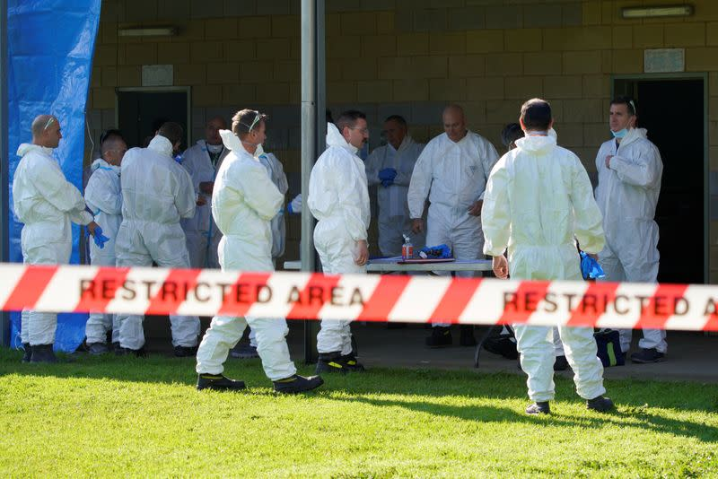 Response personnel prepare to enter a public housing tower, locked down in response to a COVID-19 outbreak, in Melbourne