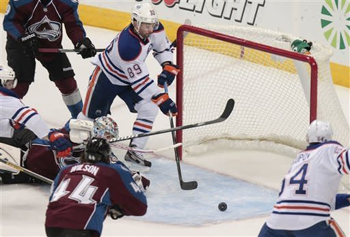 Edmonton Oilers' Sam Gagner (89) scores a goal past Colorado Avalanche goalie Semyon Varlamov (1), of Russia, during the first period of an NHL hockey game on Tuesday, March 12, 2013 in Denver. (AP Photo/Barry Gutierrez)