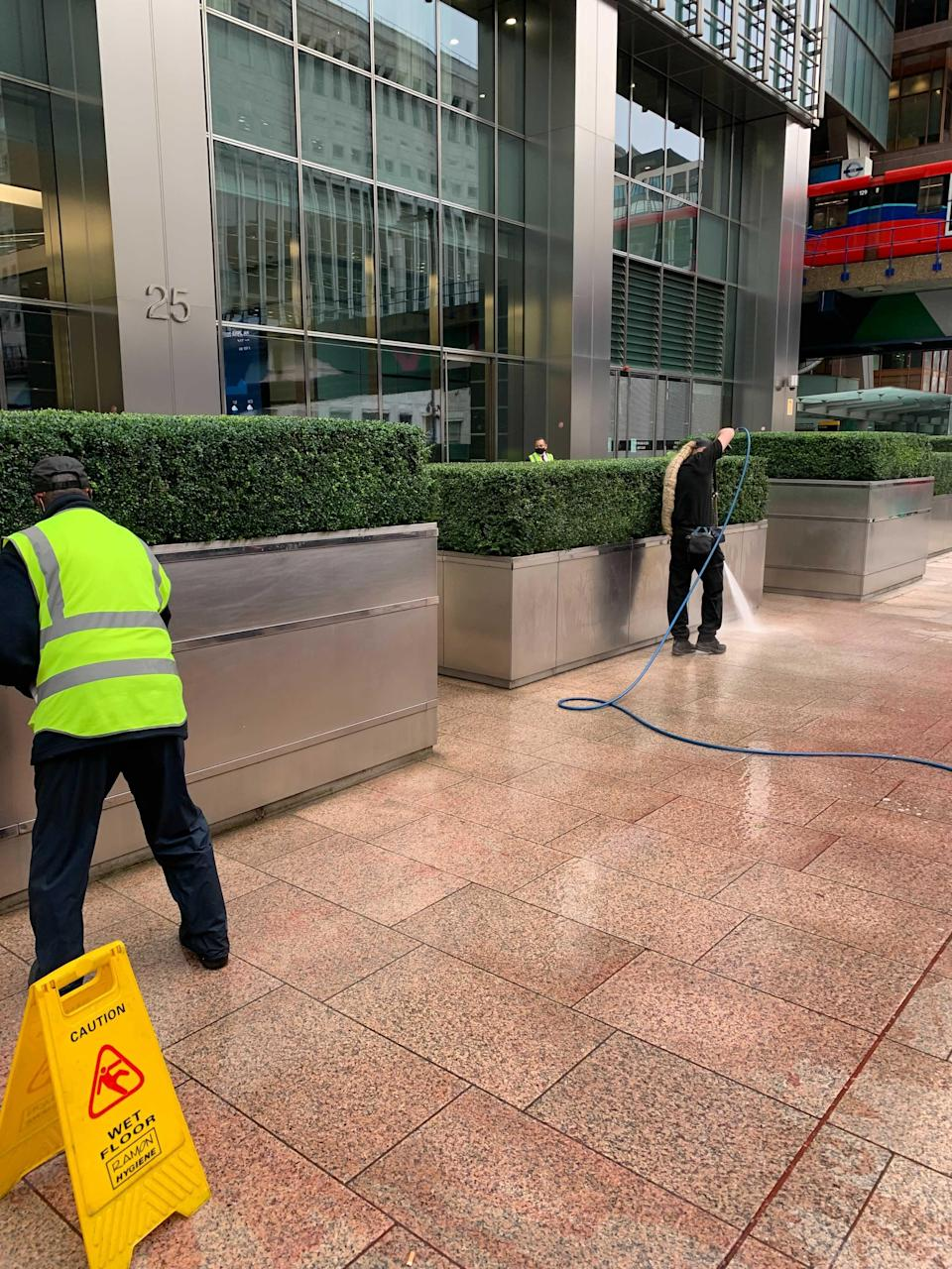 Cleaners used a pressure hose to remove the paint (The Independent)