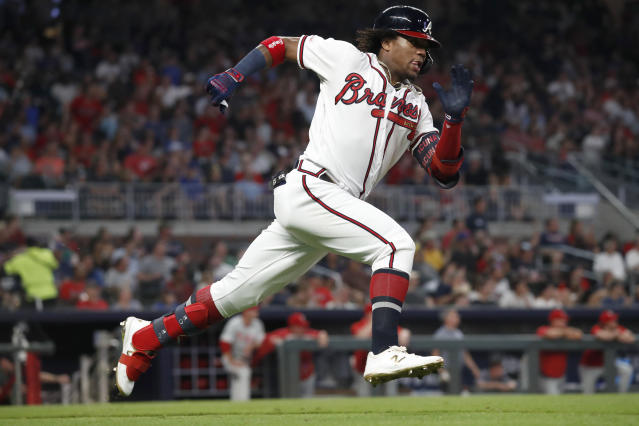 Atlanta Braves' Ronald Acua Jr. runs to first base after hitting a double during the fifth inning of the team's baseball game against the Philadelphia Phillies on Tuesday, Sept. 17, 2019, in Atlanta. Philadelphia won 5-4. (AP Photo/John Bazemore)