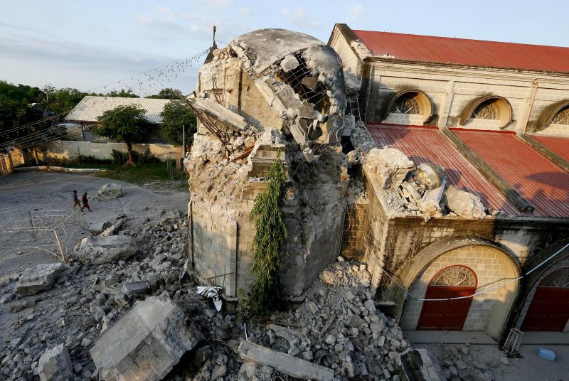The damage of St. Catherine church following a 6.1 magnitude earthquake that also caused the collapse of a commercial building, is seen in Porac township, Pampanga province, north of Manila, Philippines, Tuesday, April 23, 2019. The strong earthquake struck the northern Philippines Monday trapping some people in a collapsed building, damaged an airport terminal and knocked out power in at least one province, officials said. (AP Photo/Bullit Marquez)