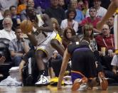 Indiana Pacers guard Lance Stephenson, left, throws the ball into play as he tumbles out out bounds and Phoenix Suns guard Goran Dragic, right, of Slovenia, looks on during the first half of an NBA basketball game Saturday, March 30, 21013, in Phoenix. (AP Photo/Paul Connors)