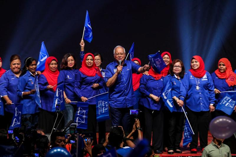 Datuk Seri Najib Razak (centre) addresses the crowd at the Putra World Trade Centre in Kuala Lumpur April 24, 2018. — Picture by Ahmad Zamzahuri