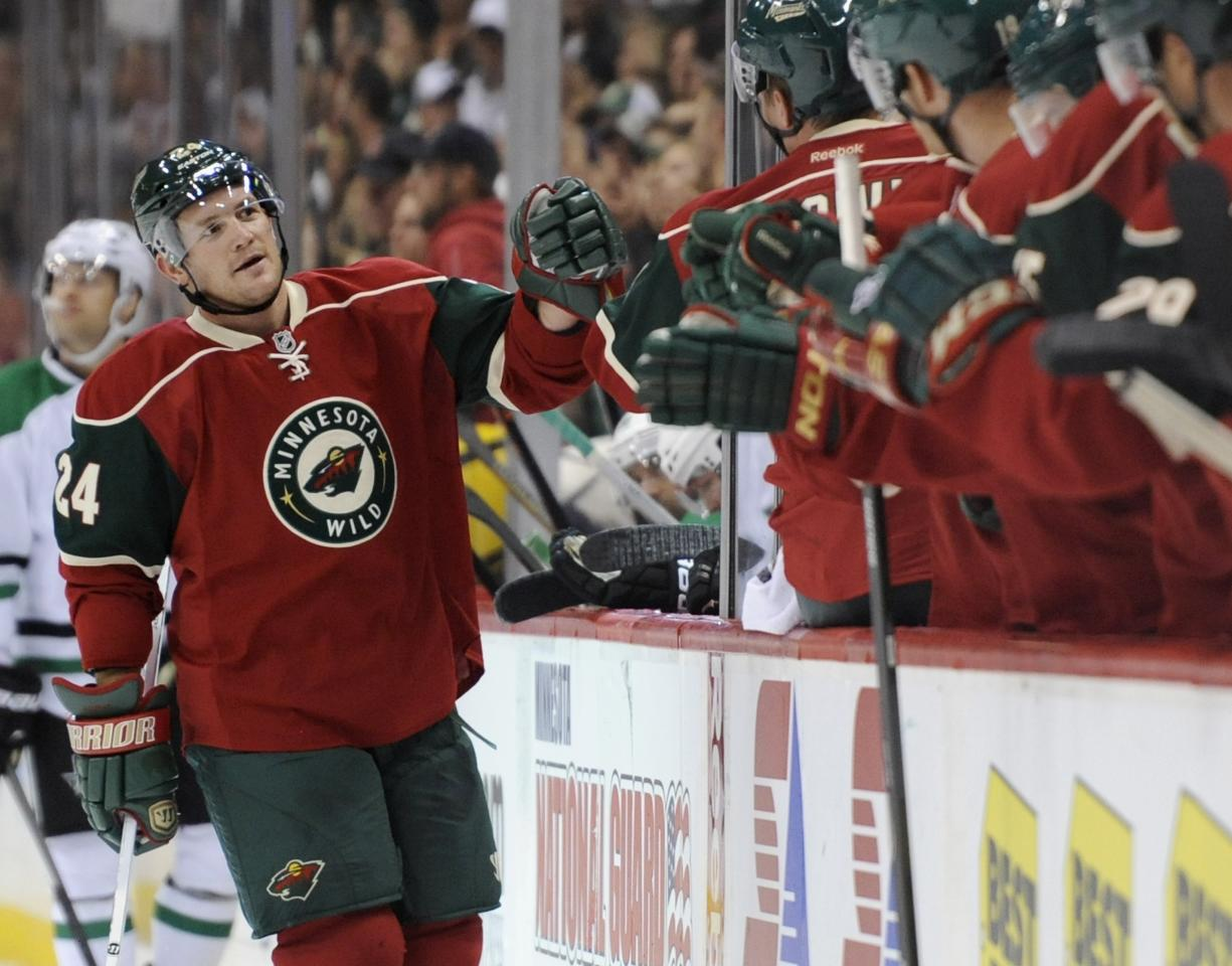 ST PAUL, MN - OCTOBER 12: Matt Cooke #24 of the Minnesota Wild celebrates scoring a goal against the Dallas Stars during the first period of the game on October 12, 2013 at Xcel Energy Center in St Paul, Minnesota. (Photo by Hannah Foslien/Getty Images)