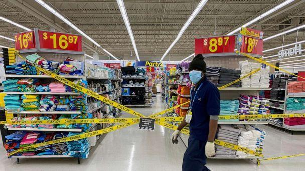PHOTO: An employee walks past cordoned off aisles of non-essential goods at a Walmart store as new measures are imposed on big box stores due to COVID-19 in Toronto, Canada, April 8, 2021. (Carlos Osorio/Reuters)