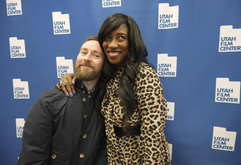 """In this May 3, 2019, photo, Aaron Ruell, who played the character Kip, and Shondrella Avery, who played LaFawnduh, hug during a photo-op as they celebrate the 15th anniversary of """"Napoleon Dynamite,"""" in Salt Lake City. (AP Photo/Rick Bowmer)"""