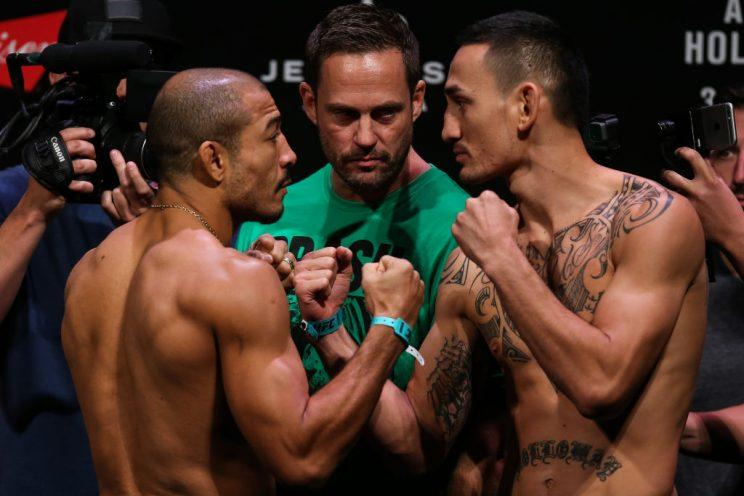 Jose Aldo (L) and Max Holloway face off after the weigh-in for their UFC 212 fight. (Getty)
