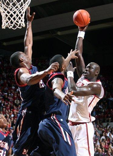 Alabama center Moussa Gueye, right, attempts a shot while being blocked by Mississippi defenders during the first half of an NCAA college basketball game in Tuscaloosa, Ala., Saturday, Feb. 4, 2012. (AP Photo/Tuscaloosa News, Michelle Lepianka) Carter)