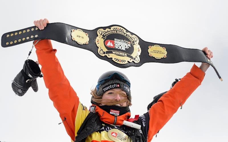 World snowboard champion Estelle Balet holds up her overall belt after winning the women's event during the Verbier Xtreme Freeride World Tour final on April 2, 2016 near the Swiss Alps resort of Verbier