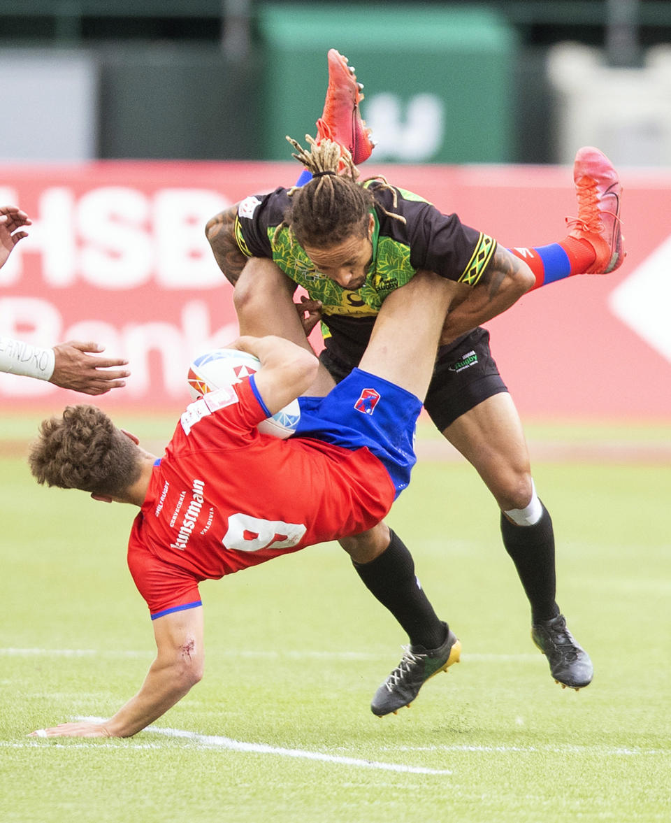 Chile's Sebastian Berti, left, is tackled by Jamaica's Mark Phillips during an HSBC Canada Sevens semifinal rugby match in Edmonton, Alberta, Sunday, Sept. 26, 2021. (Jason Franson/The Canadian Press via AP)