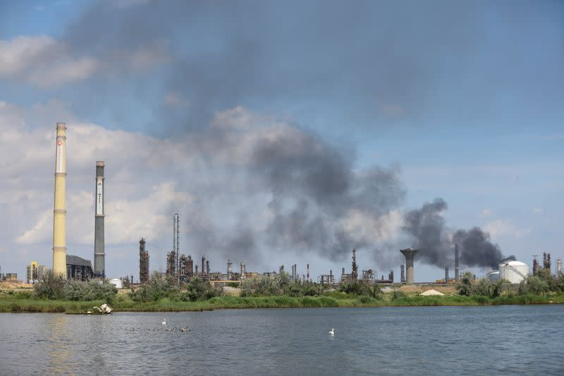 Smoke rises from inside the crude oil refinery Petromidia following a blast and fire