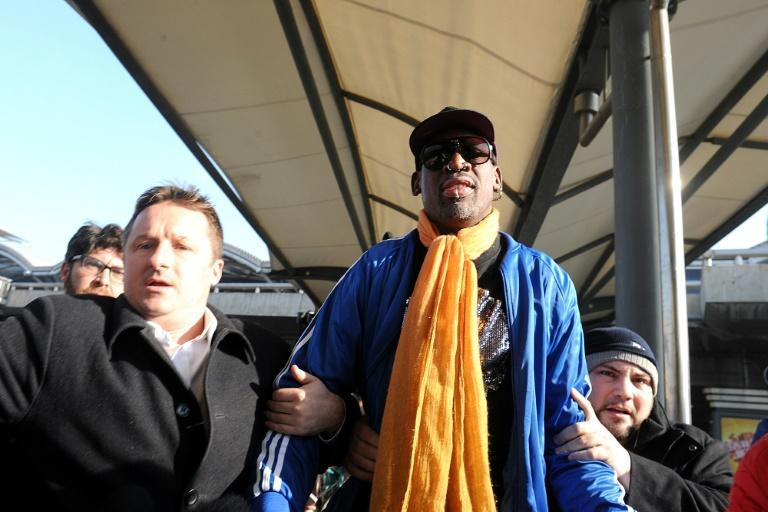 Michael Spavor was instrumental in arranging visits by former Chicago Bull Dennis Rodman (centre) to Pyongyang (AFP/WANG Zhao)
