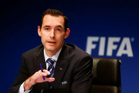 FILE PHOTO: Director of FIFA's legal division Villiger addresses a news conference in Zurich