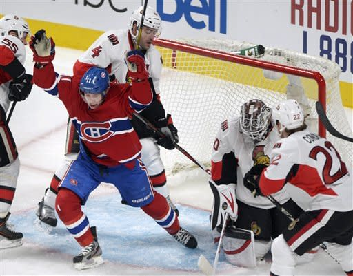 Montreal Canadiens' Brendan Gallagher celebrates after scoring against Ottawa Senators goaltender Robin Lehner, with Senators' Chris Phillips (4), Sergei Gonchar (55) and Erik Condra nearby during the second period of an NHL hockey game in Montreal, Wednesday, March 13, 2013. (AP Photo/The Canadian Press, Graham Hughes)