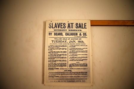 A copy of a poster dated January 19, (year unconfirmed) advertising the sale of slaves by auctioneer Beard is seen on display at the Badagry Heritage Museum in Badagry